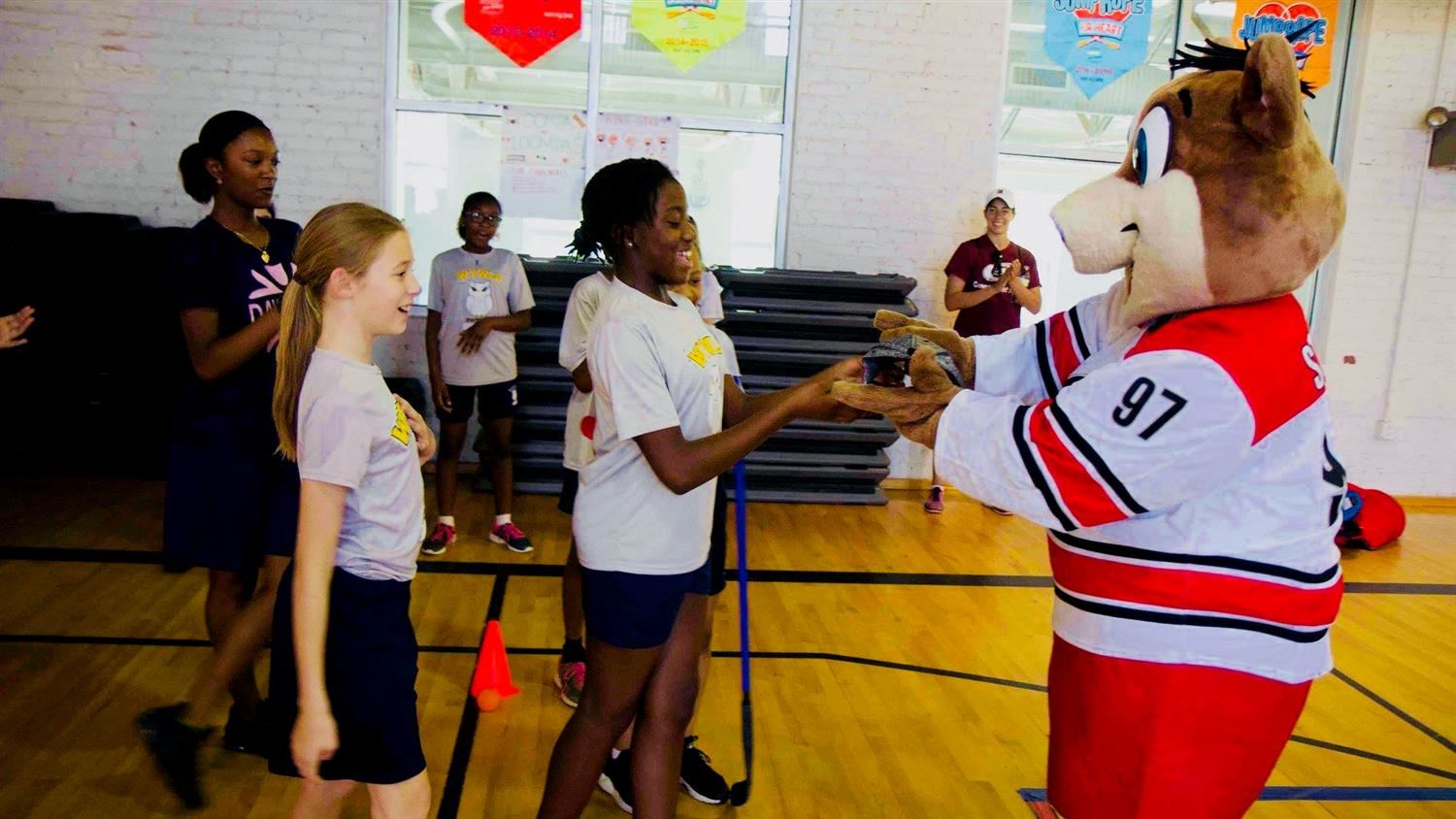 Carolina Hurricanes mascot Stormy exercise with middle school students