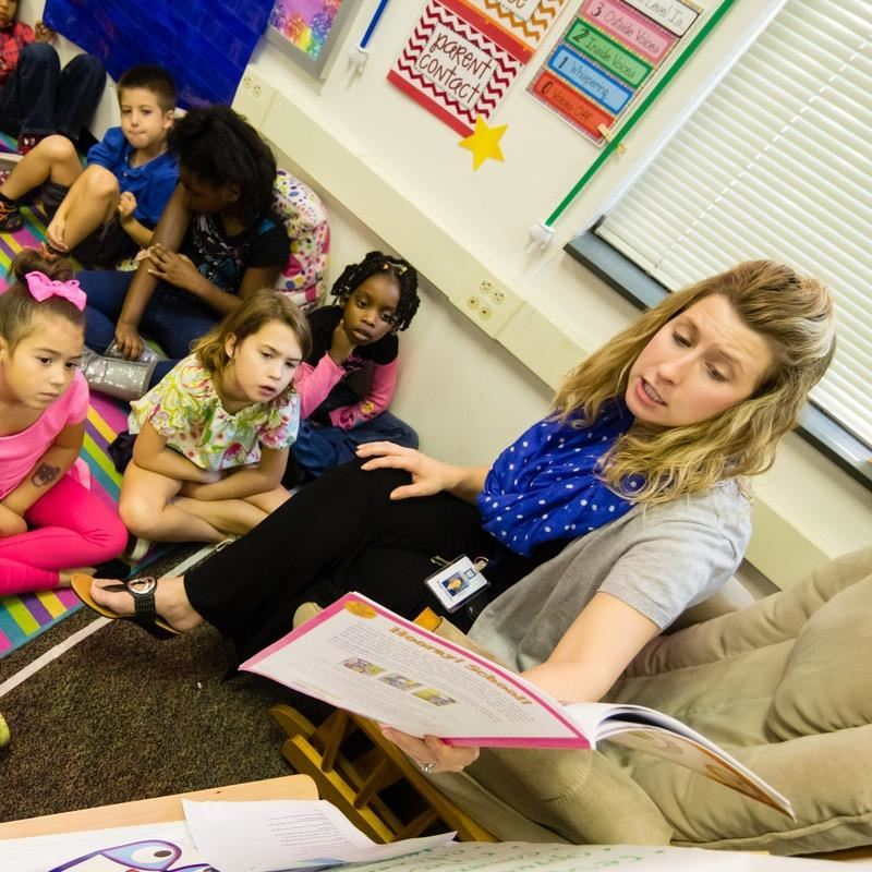 A teacher reads to students. WAKE Up and Read partnership gets national notice