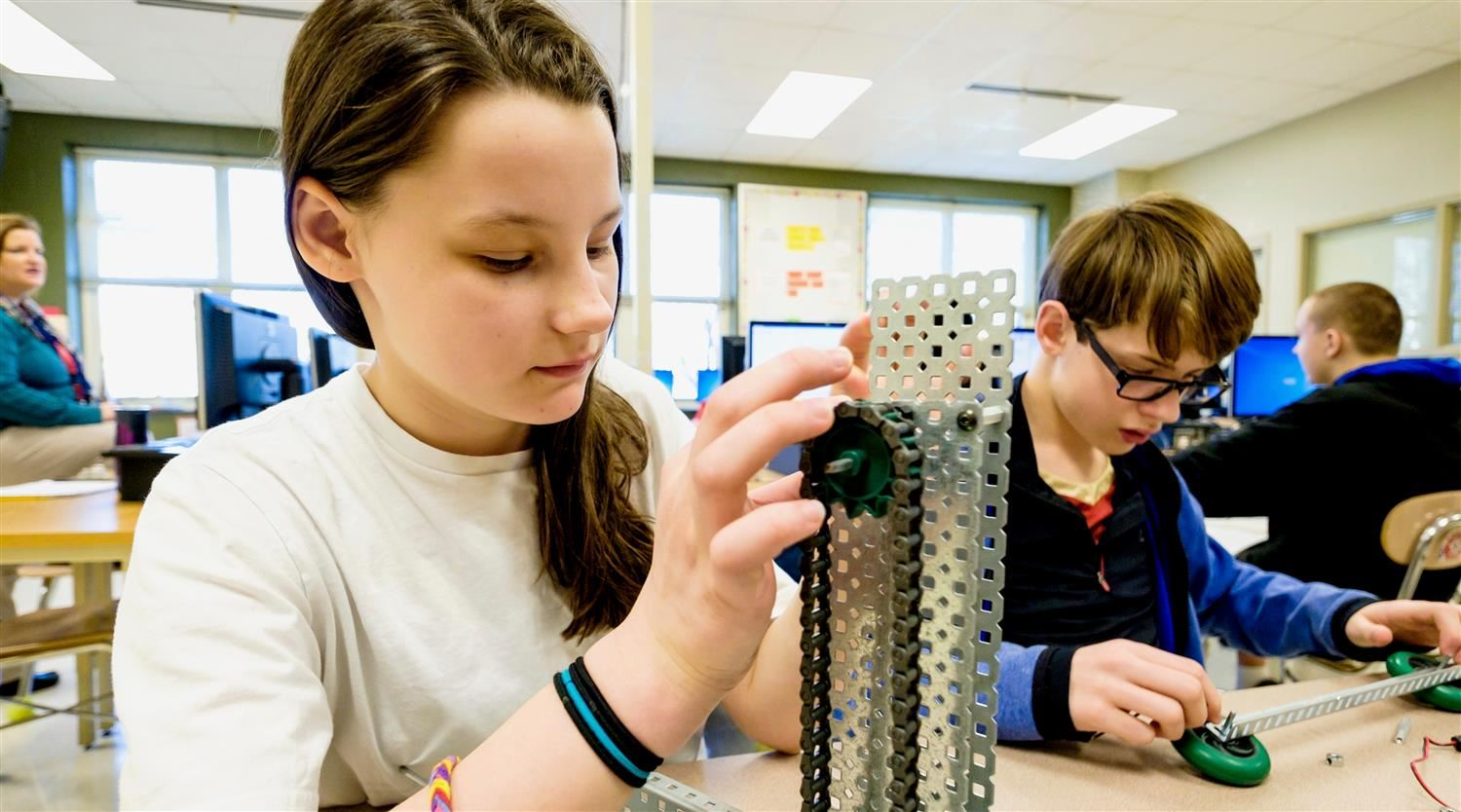 Moore Square Magnet Middle School students work on design project