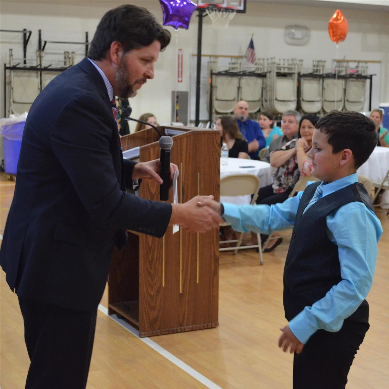 student shaking hand with assistant principal