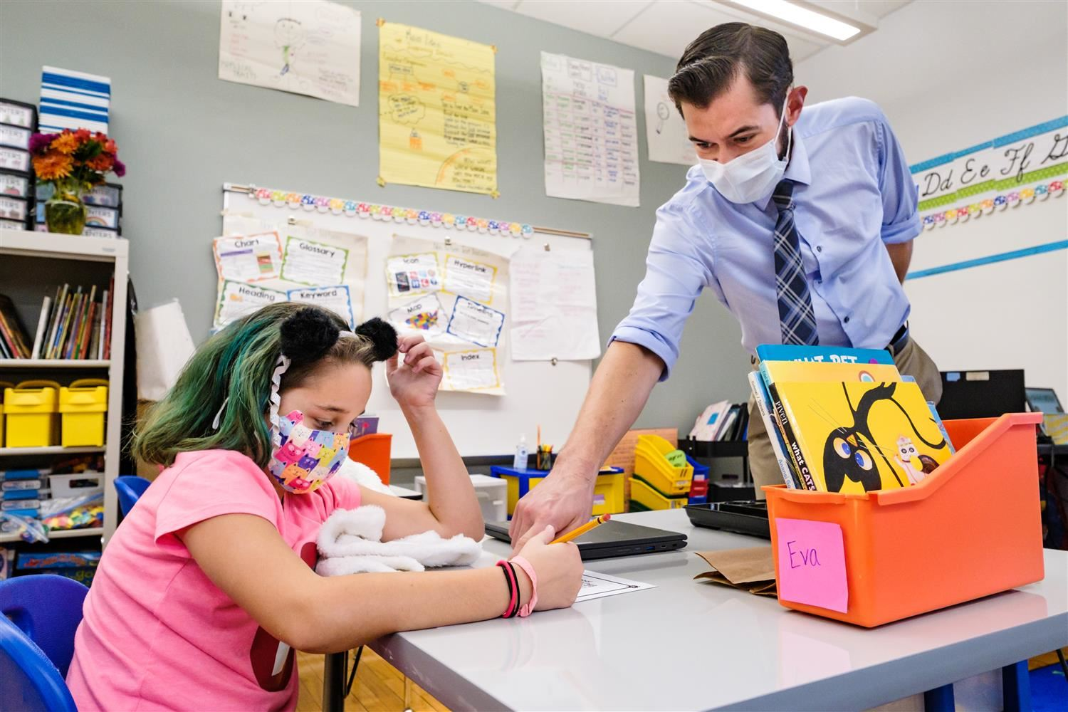teacher at Wiley helps a student