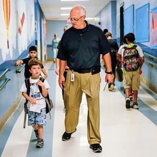 Principal walks child to class