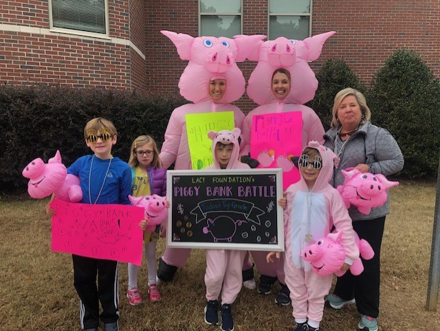 Parents and students in carpool raising money for the school