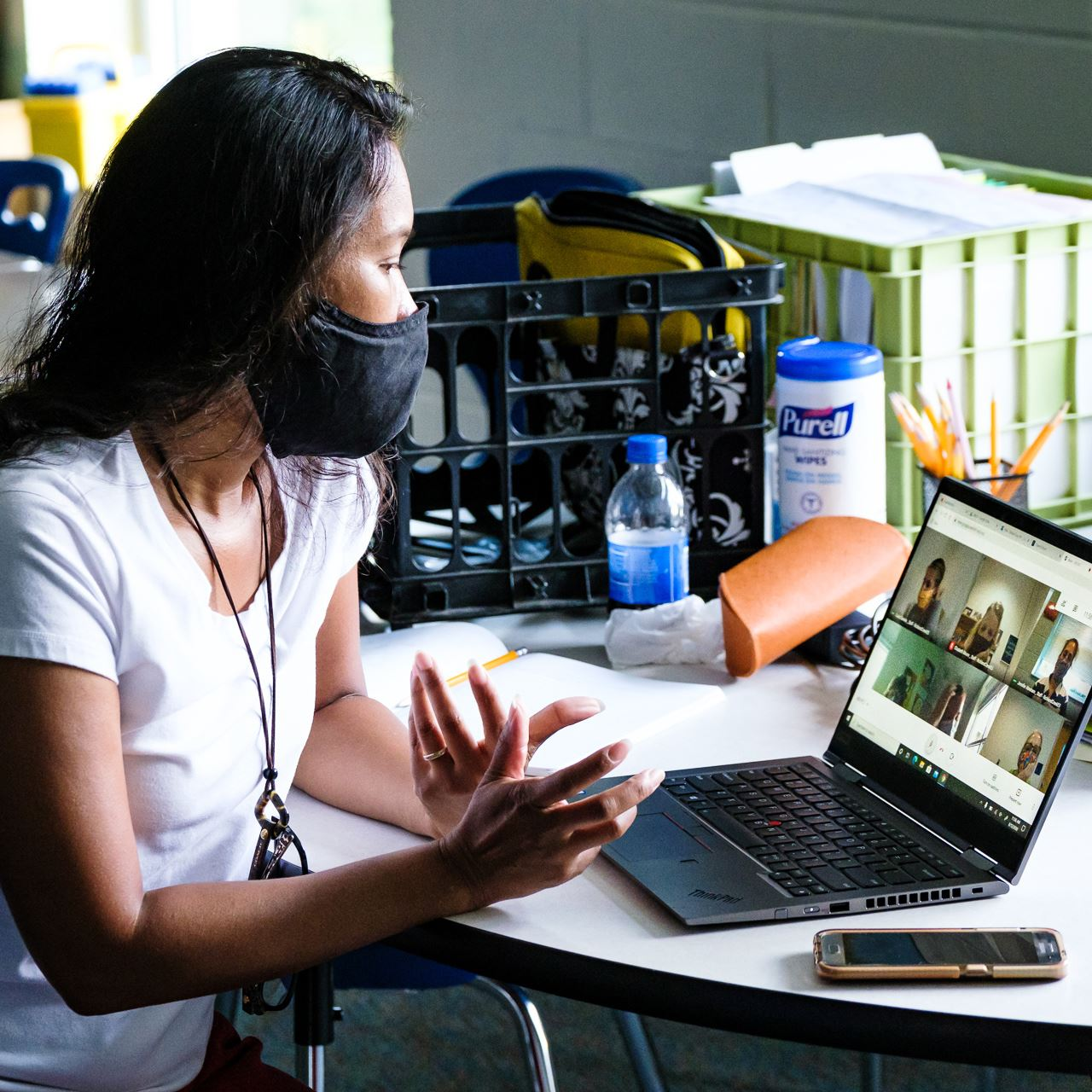 photo of a woman wearing a mask on a computer