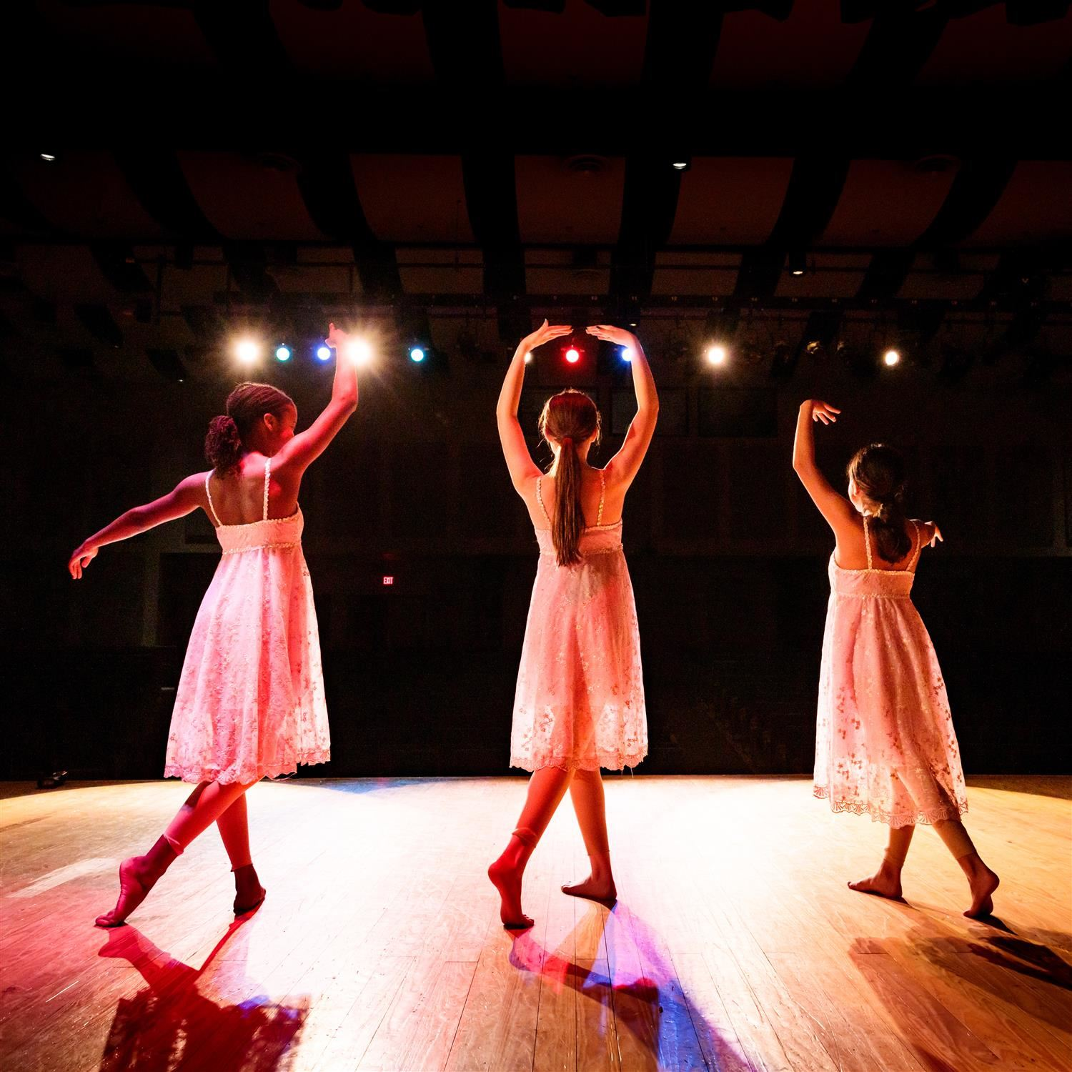 photo of three students dancing