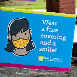 Picture of sign saying to wear a mask