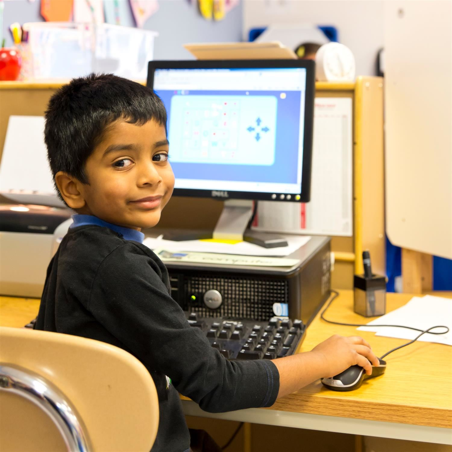 Pre-kindergarten student working on computer
