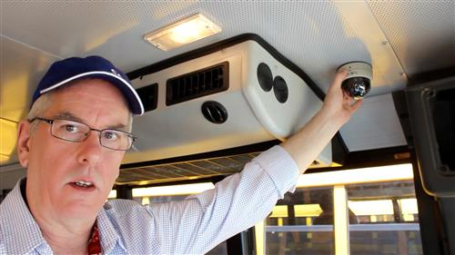 Installer shows placement of camera in bus