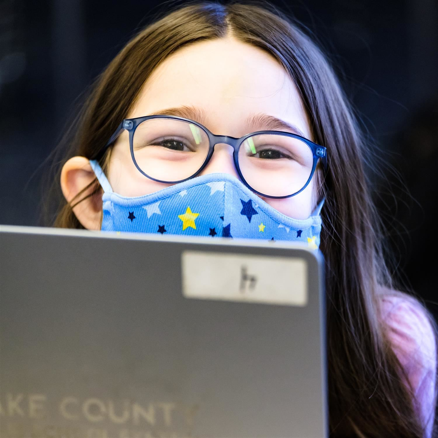 girl wearing a face mask and smiling