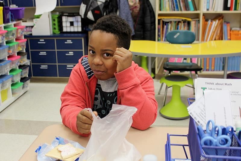 Student eats breakfast in the classroom