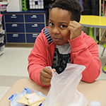 Student eats breakfast in classroom