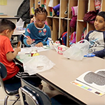 students eat breakfast in the classroom