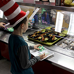 Student looks at green eggs and ham