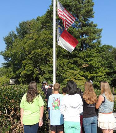 photo of students and flags