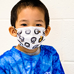 photo of boy wearing a mask
