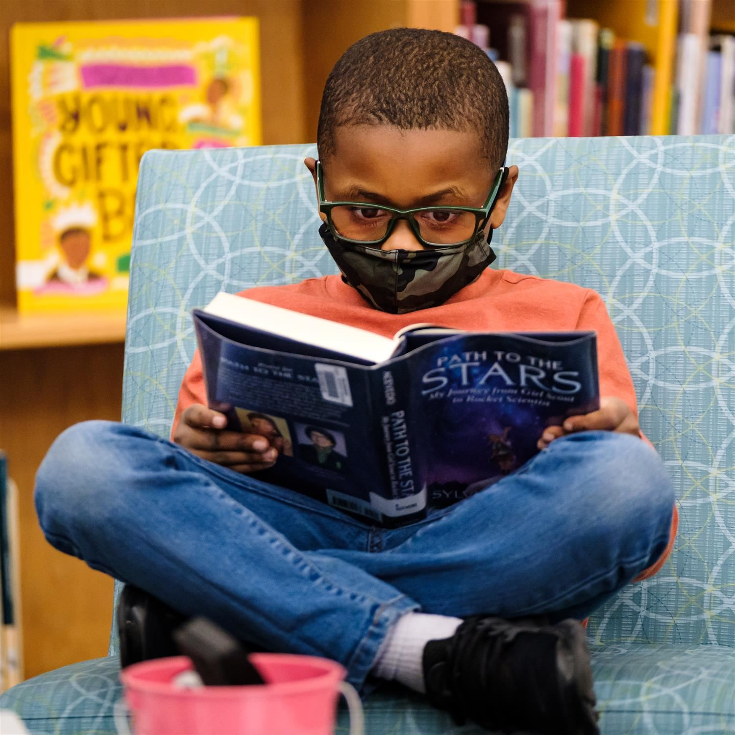 photo of boy reading a book