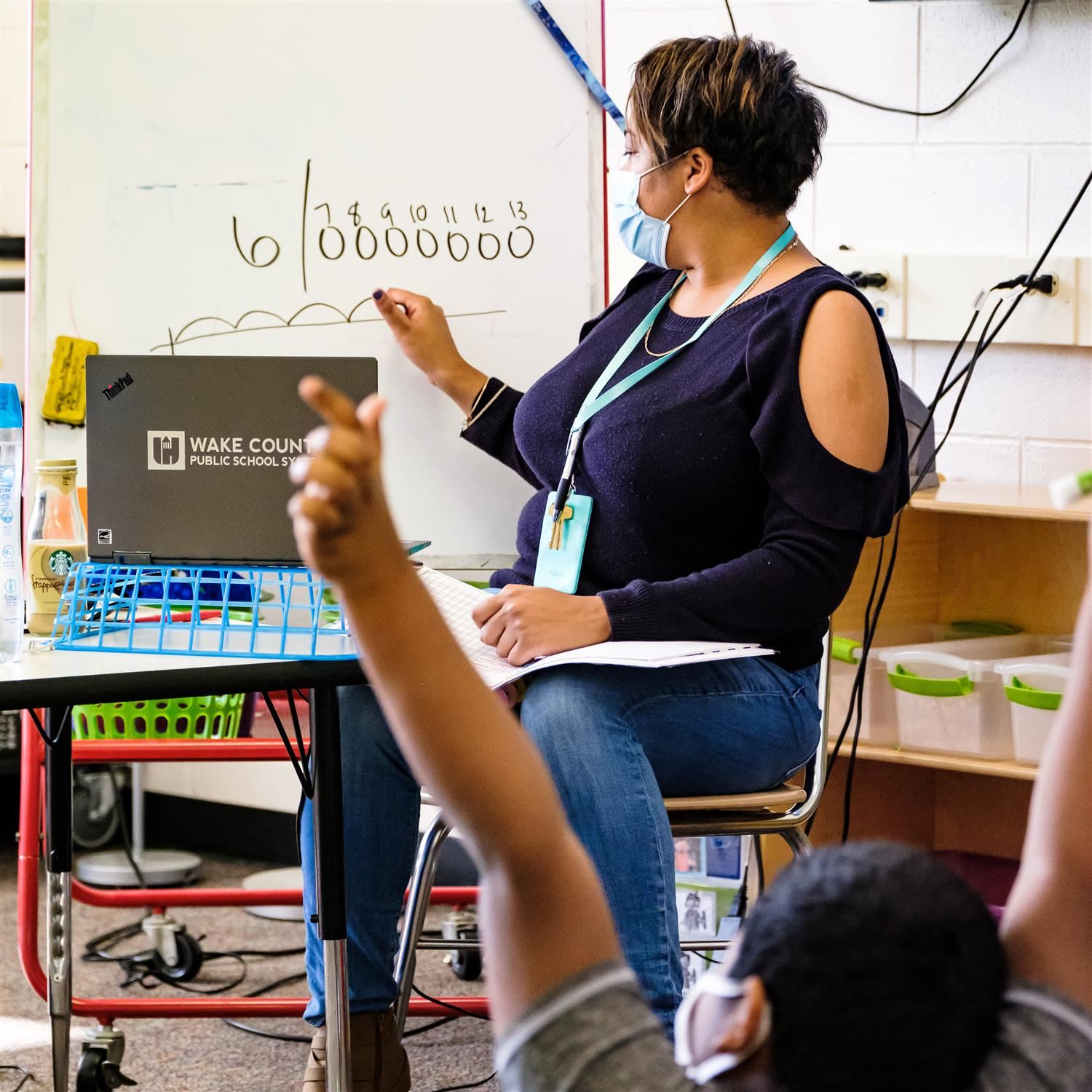photo of a teacher writing on a board