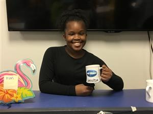 picture of young girl holding coffee mug