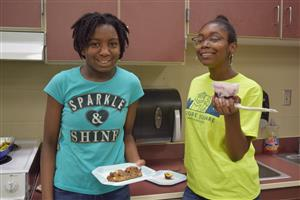 2 students enjoying their food creations