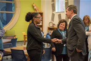 Governor Cooper shakes hands with Ms. Ferguson