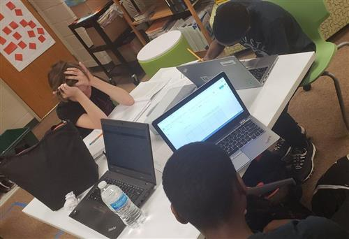 students working at computers