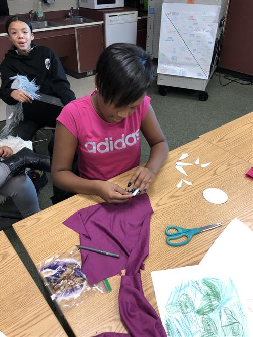 student making a fabric compass rose