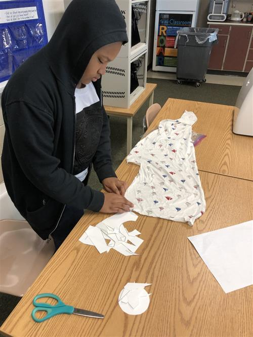Student working with fabric