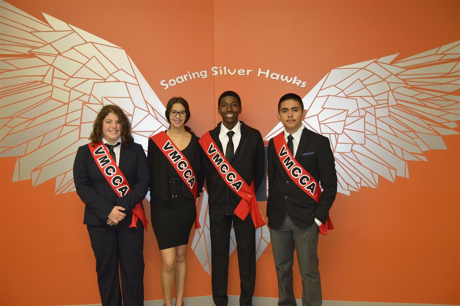 Four student leaders dressed in business attire