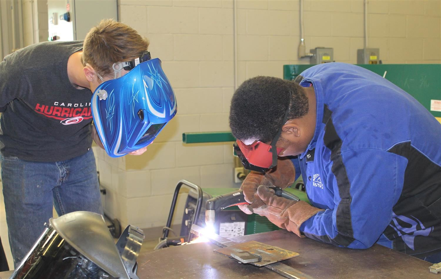Two student welding