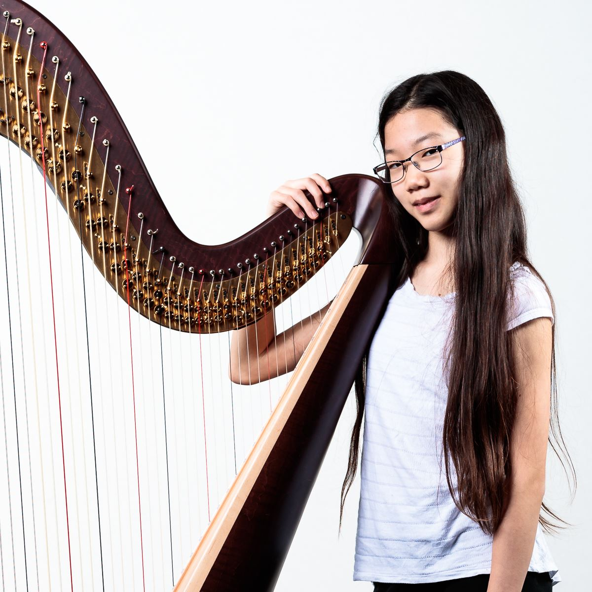 Photo of student with instrument.