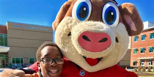 Carolina Hurricanes' mascot Stormy with a student