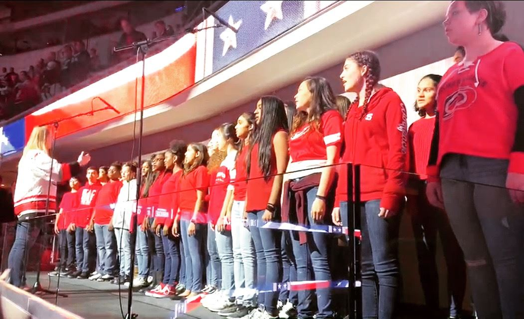 Chorus Students Sing National Anthem at a Carolina Hurricanes Game