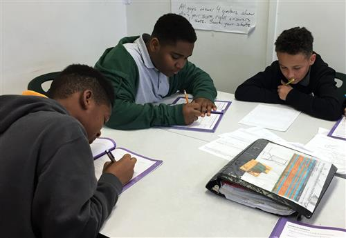 Middle School students working on math.