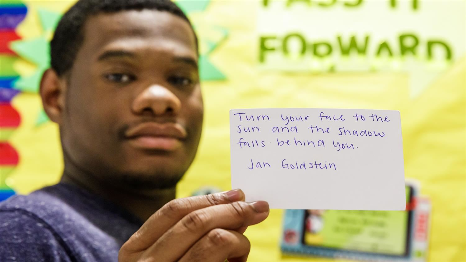 Jeremee Jeter shows one of his Pass It Forward Club's quotes