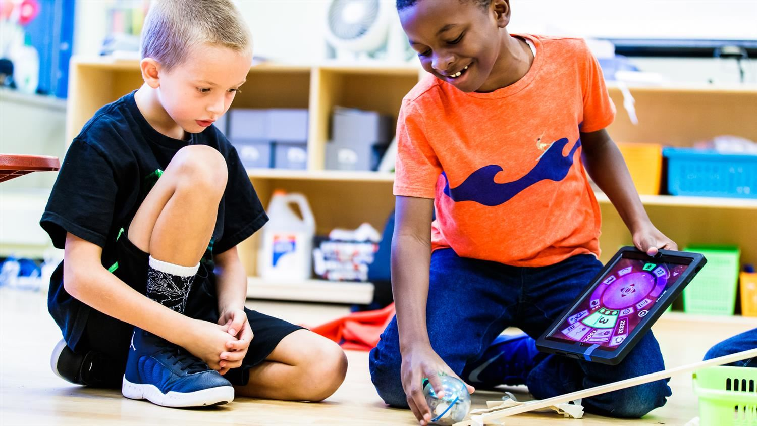 Bugg Elementary students work with a sphero robot.