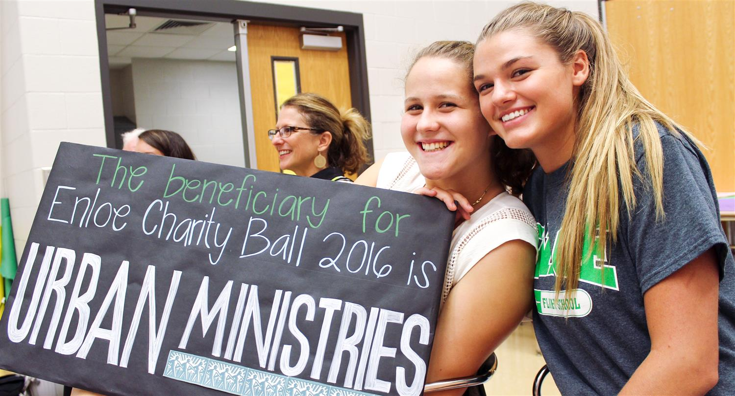 Enloe students with Charity Ball sign