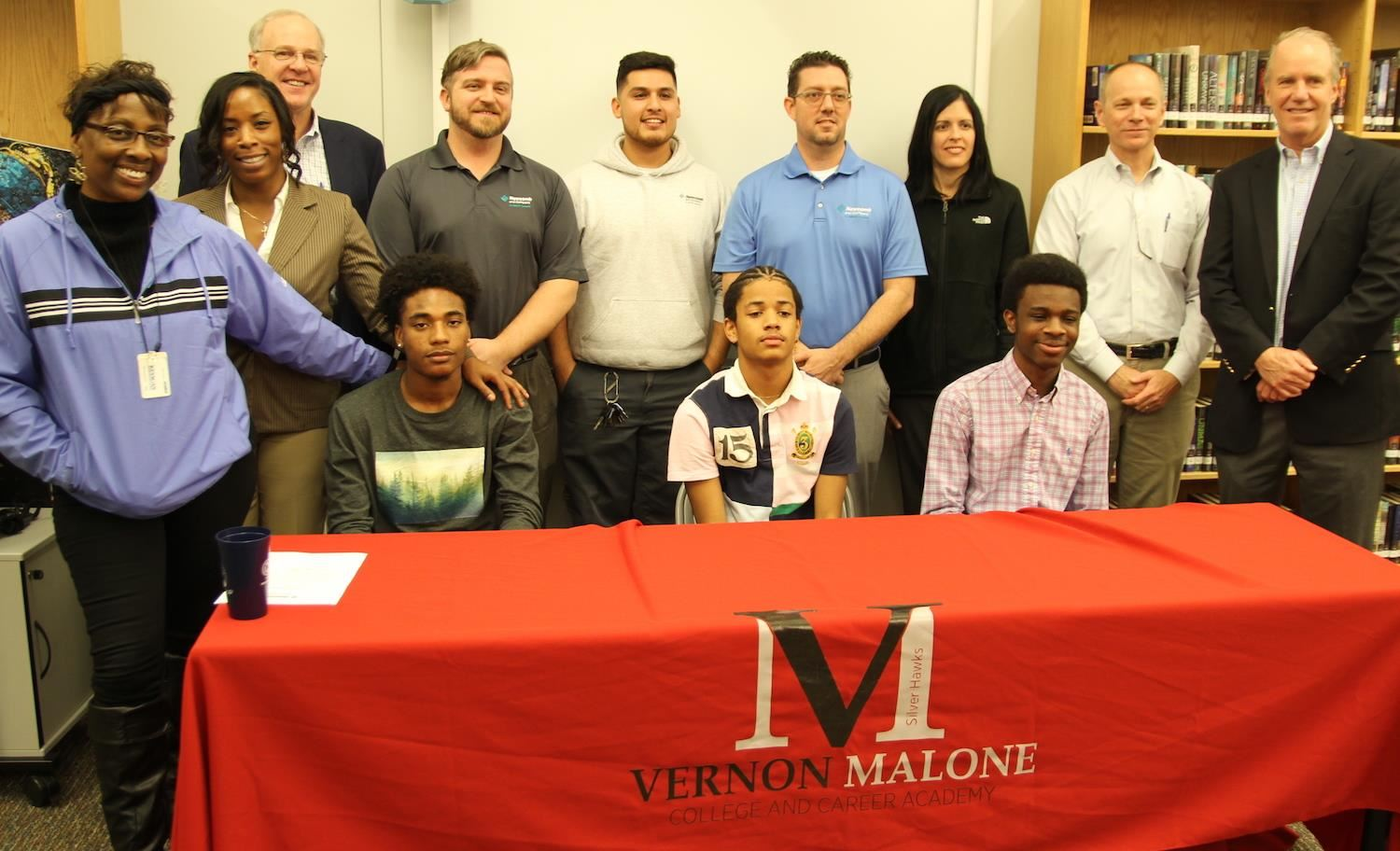 Vernon Malone College and Career Academy students signed on for well paying jobs after graduation