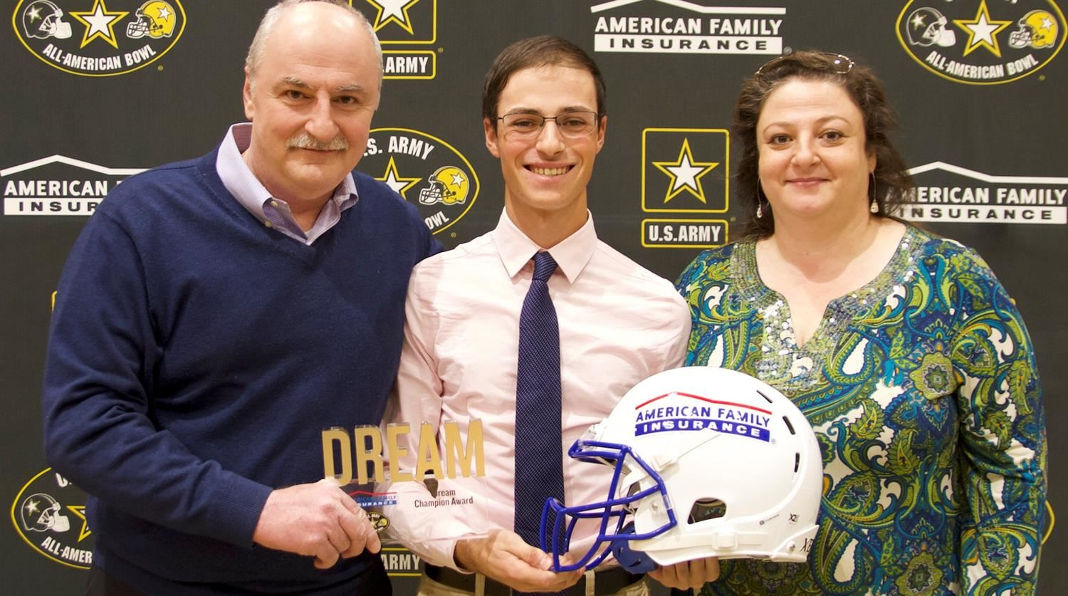 Samer issa of Green Hope High School with parents receiving All-American marching band honors.
